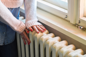 Hands on the radiator